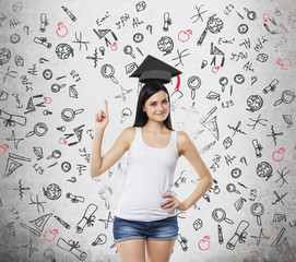 Brunette lady is presents a necessity of higher education. Graduation hat above her head. Educational icons are drawn over the concrete background.