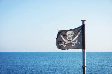 Pirate flag fluttering in the sea breeze