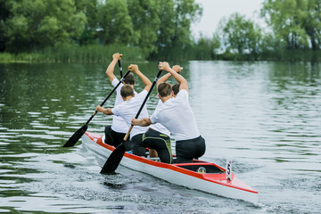 paddlers in canoe racing during