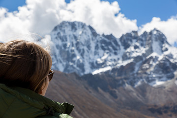 Wall Mural - Young woman tourist looking at  mountains ridge view.