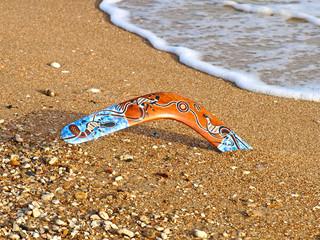 Boomerang on a beach.
