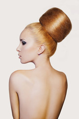 elegant woman with creative hair style. Fashion model with