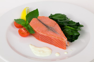 salmon steak with basil and spinach