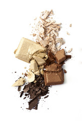 Beige and brown eye shadow cracked on background