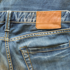 blue jeans with back pocket and brown leather tag