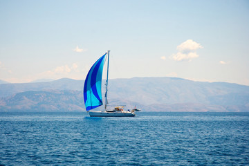 Sailing boat and coastline