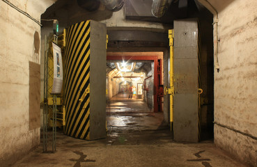 Yellow hermetic door in the underground tunnel