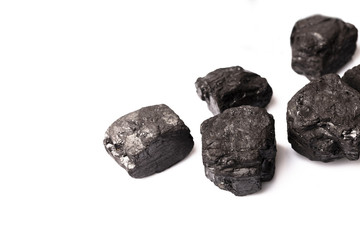 Loose lumps of black coal on white background