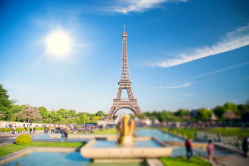 summer day the sun shines over the Eiffel Tower symbol of Paris.