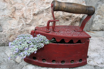 Old charcoal iron with lavender