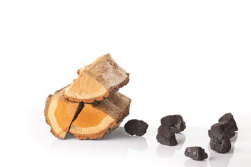 Pile of firewood and coal lumps