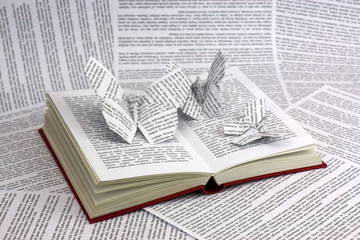 Origami butterflies coming out of a book