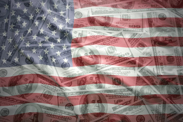 colorful waving united states of america flag on a american dollar money background