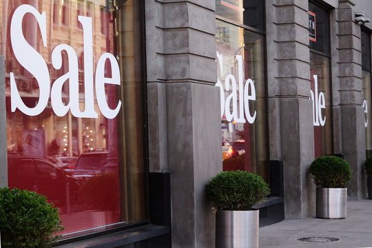 """The word """"Sale"""" on a show window"""
