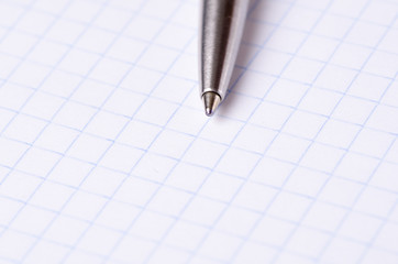 pen close-up on a notebook isolated on white background