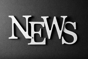 "Word ""News"" over black background"