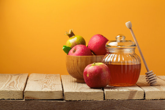Jewish holiday Rosh Hashana (new year) celebration with honey jar and apples
