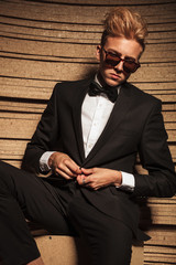 Blond young business man closing his jacket