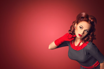 Red hair beautiful curious pin-up girl on a red background space board