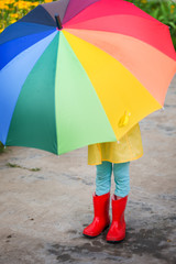 child with umbrella