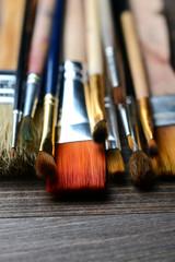 brushes on wood background