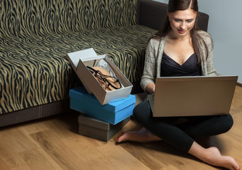 woman doing online shopping from laptop
