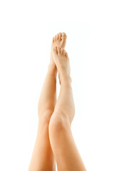 Attractive female legs, isolated on white.