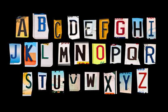 Alphabet set created with broken pieces of vintage car license plates