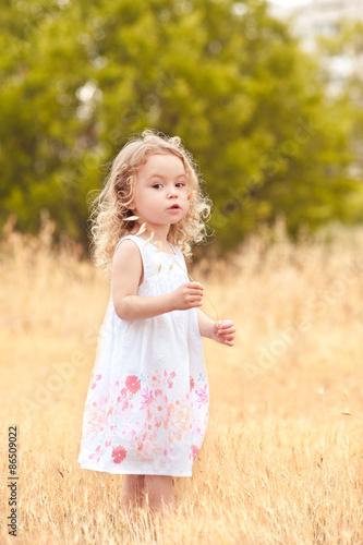 """Little baby girl 2-3 year old walking in meadow. Nature ...  ""Little ba..."