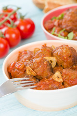 Albondigas Guisadas - Meatballs in tomato sauce with garlic slivers and thyme leaves.