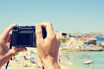 man taking a picture at Cala Conta beach in San Antonio, Ibiza I