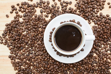 arabica coffee beans and cup full of coffee