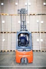 Worker Examining Stock At Warehouse