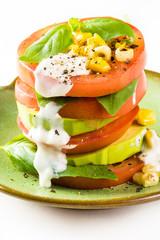 Tomato stack saladwith corn and avocado.