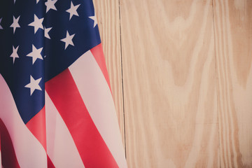 independence day 4 JULY america flag on wood background Filtered image processed vintage effect.