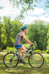 Active senior man riding a bicycle in a park
