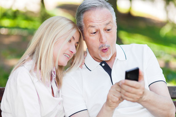 Adult couple taking a selfie at the park