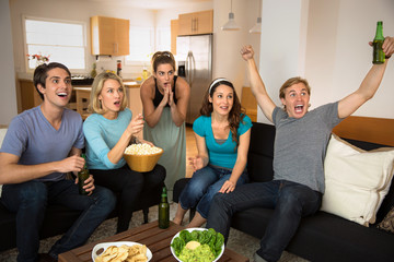 Sports friends fans cheering and celebrating exciting game on television