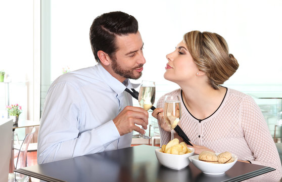 woman pulling the tie to boyfriend, couple love concept