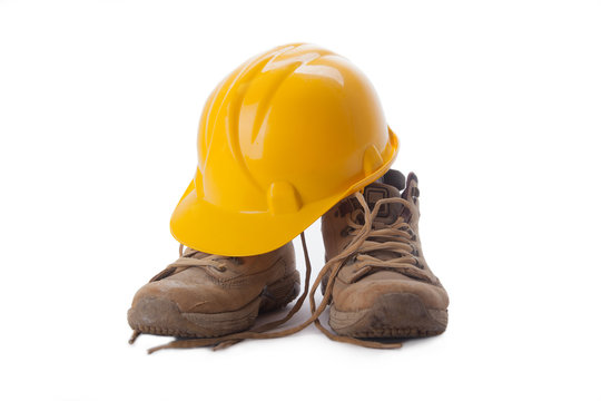 working boots and helmet isolated