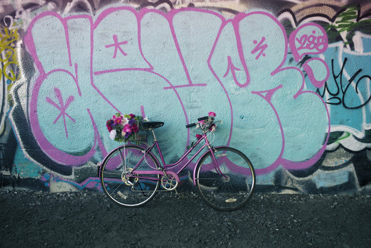 Bicycle With Flowers on Graffiti Wall