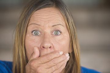 Shocked anxious upset woman portrait