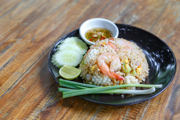 Thai fried rice on wooden desk