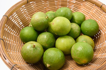 green lime in basket
