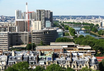 France. View  on the quay of the river Seine and the modern buildings of Paris.