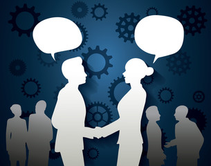 Businessman and businesswoman talking with blank speech