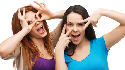 two young teenagers making faces