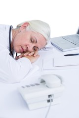 doctor sleeping on her desk