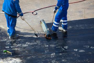 roof repair. builders surfaced rolled material