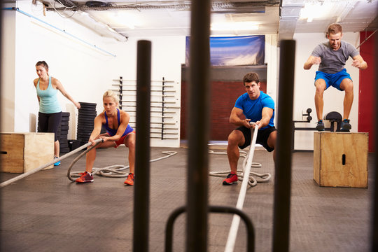 Group Of People In Gym Circuit Training